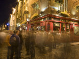 People Walking Past the Temple Bar at Night  Dublin