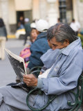 Man Reading Newspaper  Plaza de Armas  Peru