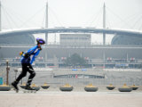 Person Rollerblading Past World Cup Stadium  North of River  Seoul  South Korea