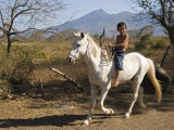 Boy Riding White Horse Bareback with Volcan Mombacho in Background  Granada  Nicaragua