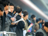People Studying Form Guide at Seoul Racecourse  Seoul  South Korea