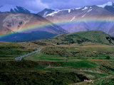 Rainbow over Road Leading to Snow-Capped Mountains  Arthur's Pass National Park  New Zealand