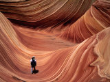 Man Walking through the Wave Formation  Vermillion Cliffs National Monument