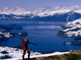 Cross Country Skier with Lake and Mountains in Background