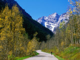 Cyclist on Road to Maroon Bells  Aspen  Colorado