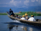 Passengers Riding High in a Traditional Boat on Lake Inle  Myanmar
