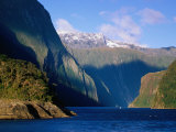 Boat in Distance Between Mountains  Milford Sound  New Zealand