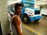 Man Waits for Bus in Torrential Tropical Downpour in Zona Centromexico