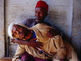 Man Holding Other Man Sick with Malaria  Ethiopia