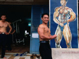 Weight Lifter Flexes at Facility Inside Cao Dai Temple Complex  Tay Ninh  Vietnam