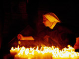 Nun Attending Candles at Stone Gate Shrine  Zagreb  City of Zagreb  Croatia