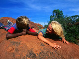 Children Lying on a Rock in the Western Desert  Western Australia