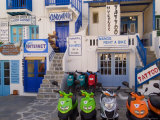 Motorbikes Parked Outside Shops