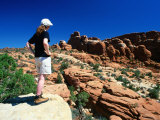 Girl Looking Across Rocky Landscape at Fiery Furnace  Arches National Park  Utah