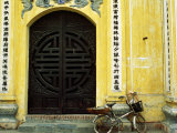 Yellow Nguyen Thai Hoc Temple Entrance and Bicycle  Hanoi  Vietnam