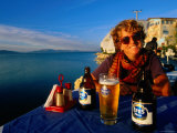 Smiling Female with Beer at Seaside Cafe on Yesilada Island  Egridir  Isparta  Turkey