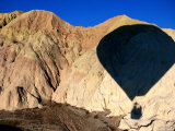 Shadow of Hot-Air Balloon over Barren Landscape Near Goreme  Cappadocia  Nevsehir  Turkey