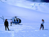 People Sightseeing at Top of Glacier with Helicopter Behind  Fox Glacier  New Zealand
