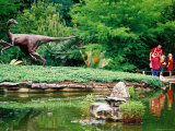 Children and Adult Standing near Ornithomimus Dinosaur Sculpture  Austin  Texas