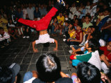 Youth Breakdancing with Crowd in Park on Dong Khoi Street  Ho Chi Minh City   Vietnam