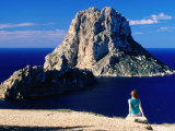 Girl on Rock Looking at Offshore Isle of Es Vedra  Ibiza  Spain
