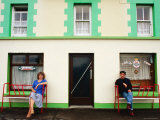 Man and Woman Sitting Outside Pub Entrance  Adrigole  Munster  Ireland