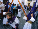 Children in Masks and Holding Sticks for Semena Santa Celebrations  Cordoba  Andalucia  Spain