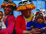 Two Mothers with Children in Traditional Colourful Clothing  Pisac  Cuzco  Peru