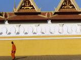 Lone Monk Passes Walls of Royal Palace  Phnom Penh  Cambodia