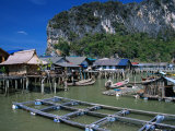 Stilt Village with Net Farms in Front and Karst Formations Behind  Ko Panyi  Phang-Nga  Thailand
