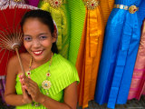 Girl Selling Dresses and Costume Materials Outside Temple of Dawn  Bangkok  Bangkok  Thailand