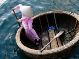 Woman Rows Basket Boat on Vietnam's South Central Coast  Nha Trang  Khanh Hoa  Vietnam