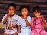 Three Children Eating Icy-Poles  Bengali Basti  Delhi  India