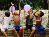 Local Boys Toss Balloons Outside Preah Kahn Temple  Siem Reap  Cambodia