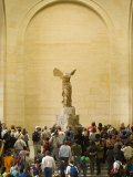 Interior of The Louvre Museum Showing Winged Victory Statue and Tourists  Paris  France