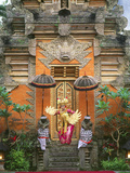 Balinese Dancer Wearing Traditional Garb Near Palace Doors in Ubud  Bali  Indonesia
