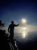 Silhouette of Fisherman Casting a Line into Lake  Ontario  Canada