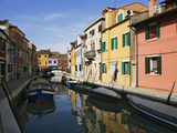 Boats and Colorful Reflections of Homes in Canal  Burano  Italy