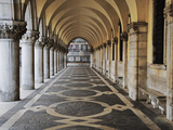 Columns and Archways Along Patterned Passageway at the Doge&#39;s Palace  Venice  Italy