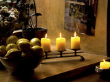 Still Life with Lighted Candles and Bowl of Lemons in Coffee Shop  Tallinn  Estonia