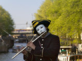 Clown Playing Flute by the Canal  Amsterdam  Netherlands