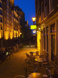 Buildings with Historic Facade and Narrow Lane at Night  Amsterdam  Netherlands