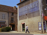 Man Walking Under Faded Advertisement for Dubonnet  Village in Cote Chalonaise  Bourgogne  France