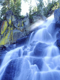 Waterfall Cascades Past Lichen-Covered Rocks  Sierra Nevada Mountains  California  USA