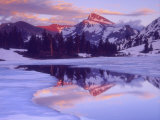 Mount Dana at Sunset Reflecting in Partially Frozen Lake  Sierra Nevada Mountains  California  USA