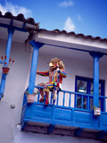 Man on Balcony Rail During Village Festival  Chinceros  Peru