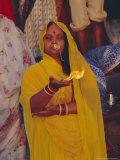 Hindu Woman Pilgrim Holding Fire  Varanasi (Benares)  Uttar Pradesh State  India