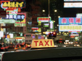 Taxi Sign and Neon Lights at Night on Nathan Road  Kowloon  Hong Kong  China  Asia