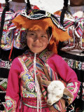 Portrait of a Local Smiling Peruvian Girl in Traditional Dress  Holding a Young Animal  Cuzco  Peru