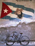 Mural of Camilo Cienfuergos on Wall Above a Bicycle  Havana  Cuba  West Indies  Central America